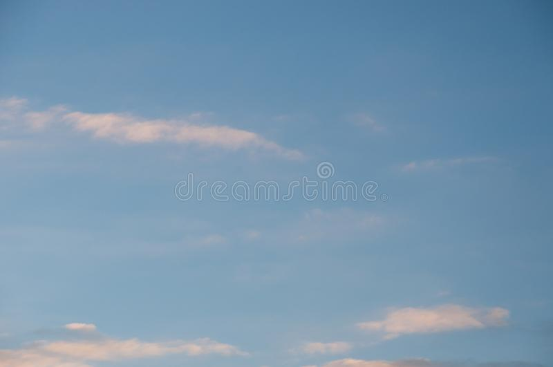 Small clouds in a blue sky royalty free stock photo