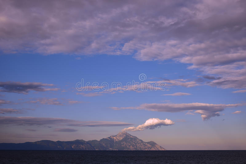 Beautiful sky with clouds above mountain. Beautiful sky with clouds above Holy Mountain Athos, Greece stock photo