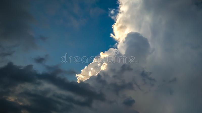 Beautiful sky with the clouds of different colours. Attempting to rain stock photography