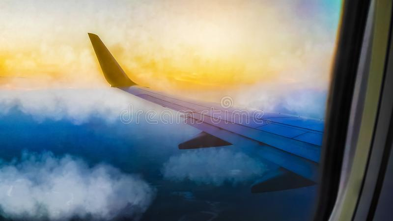 Beautiful sky and clouds, View from a commercial airplane window, Flight and holiday travel, Wing aircraft at sunset.  royalty free stock photos