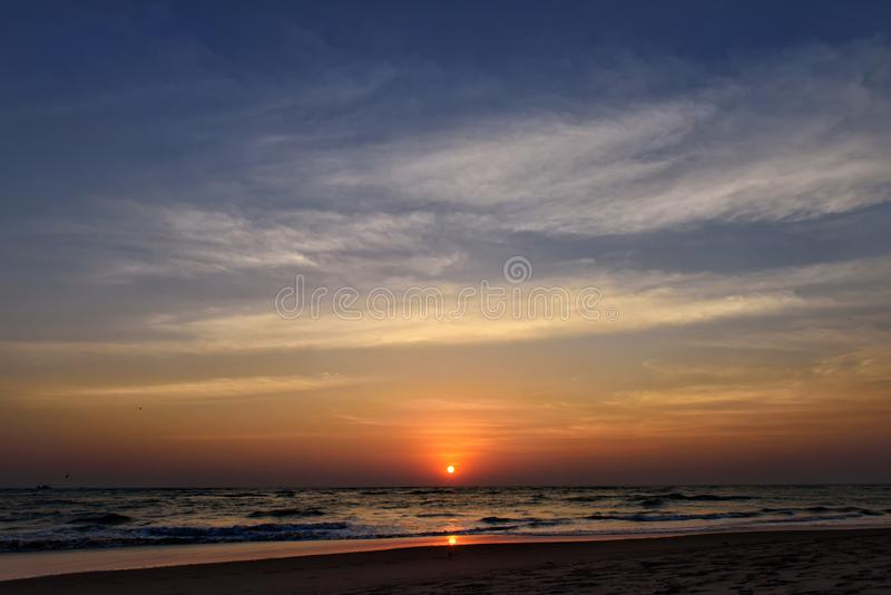 Beautiful sky colorful sunset on the ocean, natural landscapes. Deserted beach, the sun sets in the clouds above the sea royalty free stock images