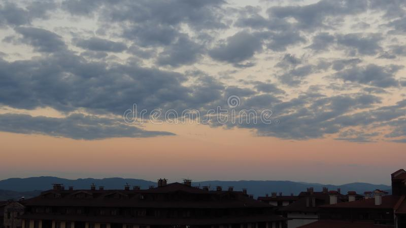 Beautiful sky and colourful clouds at sunset time over the mountains and town. Pure photo. No postprocessing no Photoshop. Beautiful sky and colourful clouds at royalty free stock image