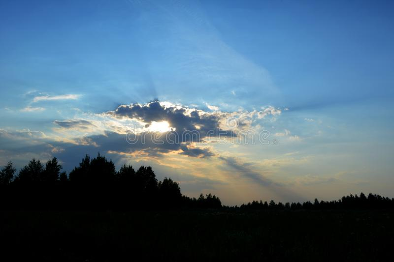 Beautiful sky with dramatic light. Clouds on the sun in the evening stock photo