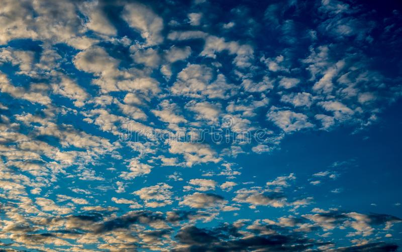 Beautiful sky with fluffy clouds. During sunset stock image