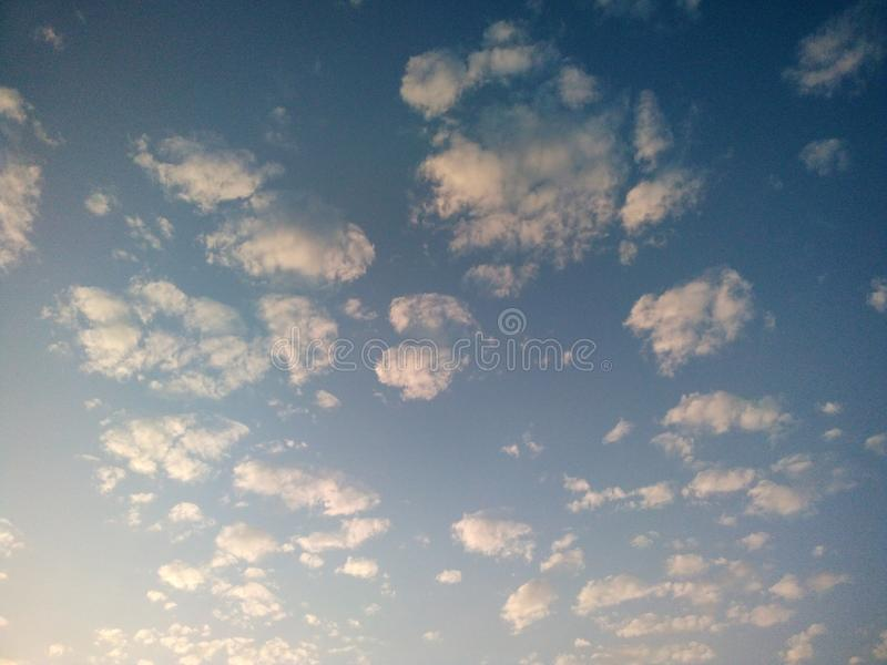 Beautiful sky with fluffy white clouds royalty free stock image