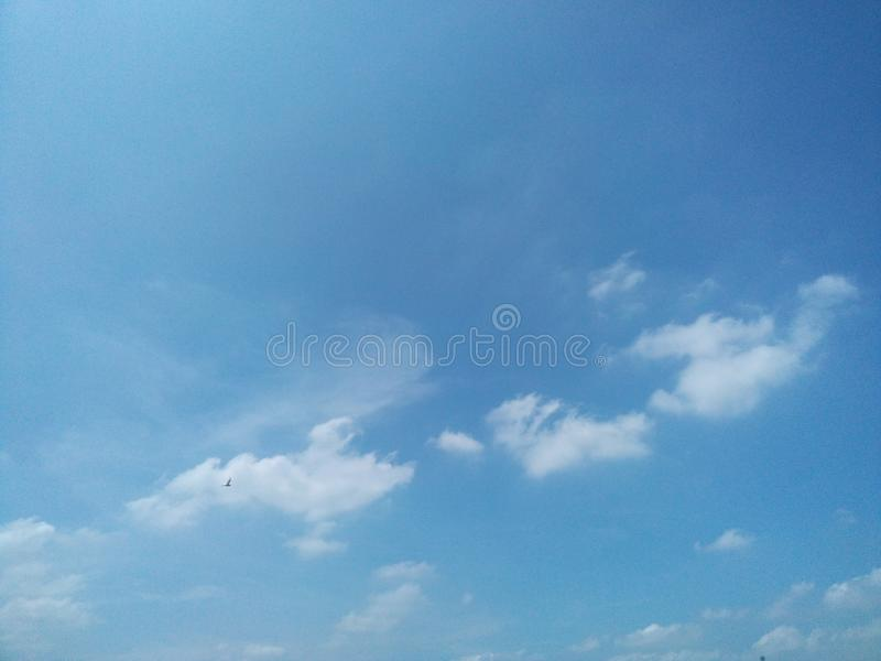 Beautiful sky Fluffy white clouds, bright sky royalty free stock photo