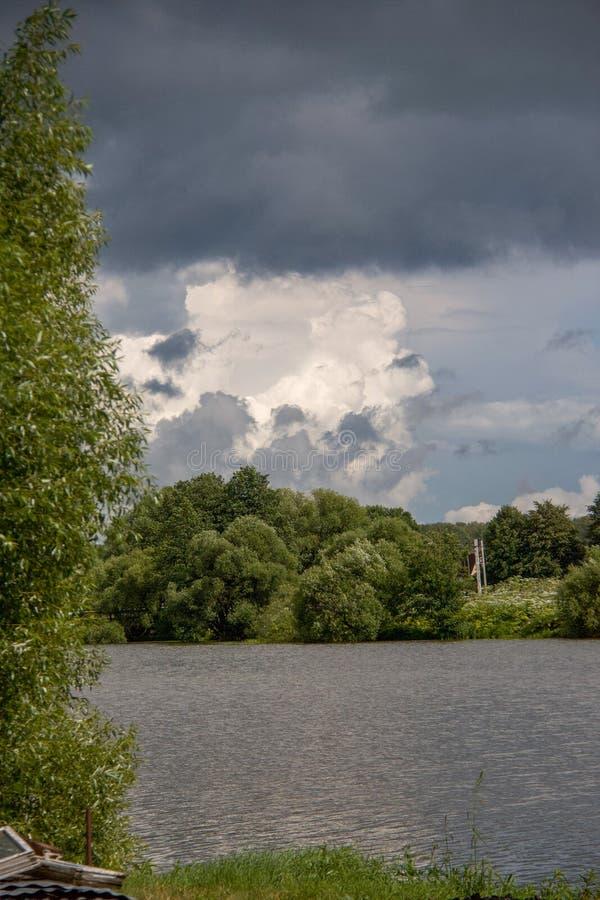 Beautiful sky full of clouds. Weekend in Russian countryside: Beautiful sky full of clouds stock photo