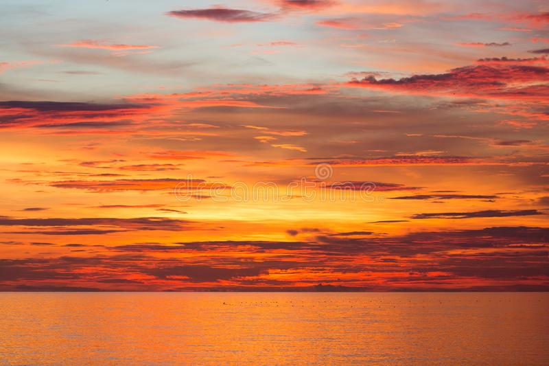 The beautiful sky is made up of clouds. And the sun shines up to create a beautiful color stock image