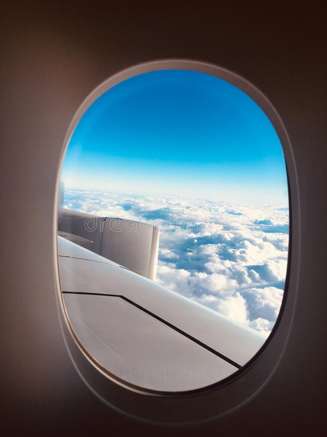 Sky out of plane window stock image