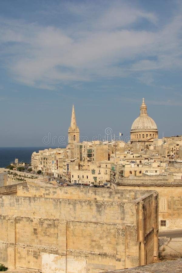 Beautiful sky over the ancient city of Valletta, the capital of the island of Malta. Blue sky with light clouds over magnificent architecture. Yellow buildings royalty free stock photos