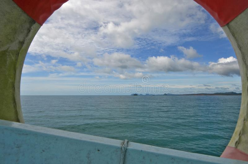 Beautiful sky over the sea in the frame of lifebuoy. On a travel ship stock image