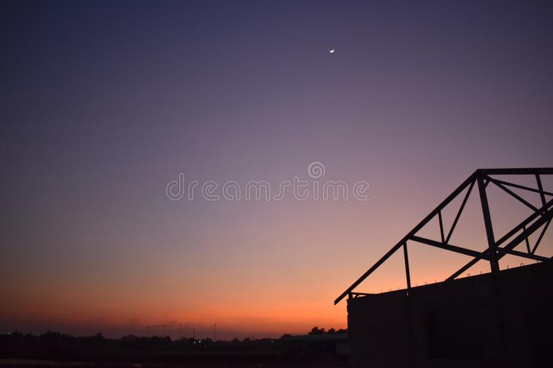 Beautiful sky. And silhouette structure house royalty free stock photo