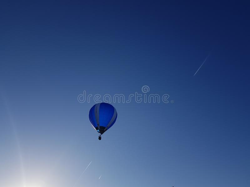 Beautiful sky sunrays and clouds, picturesque view with balloon. Beautiful sky sunrays and clouds, picturesque view with stock photography
