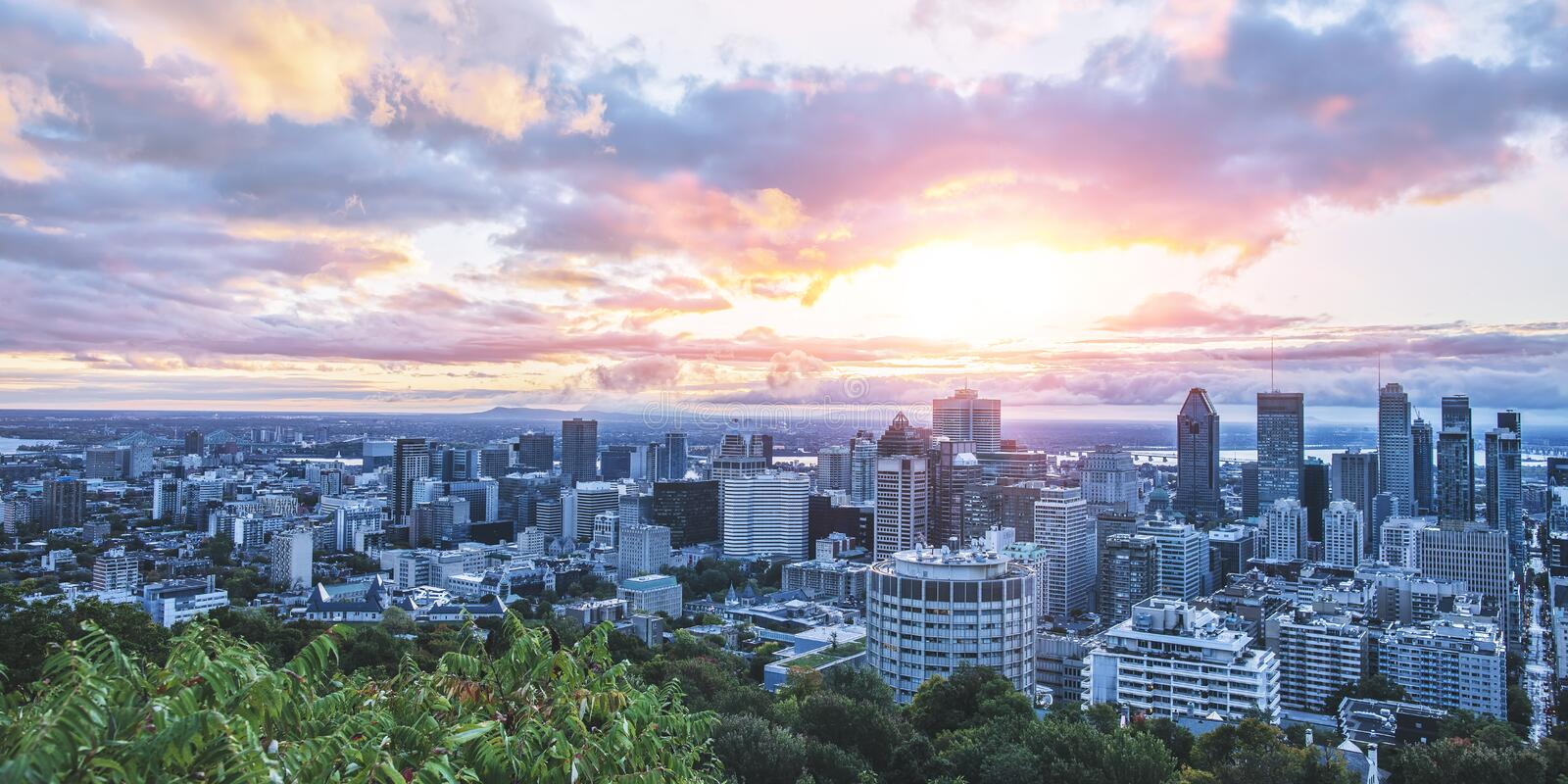 Beautiful sky and sunrise light over Montreal city in the morning time. Amazing view from Mont-Royal with colorful blue royalty free stock photos