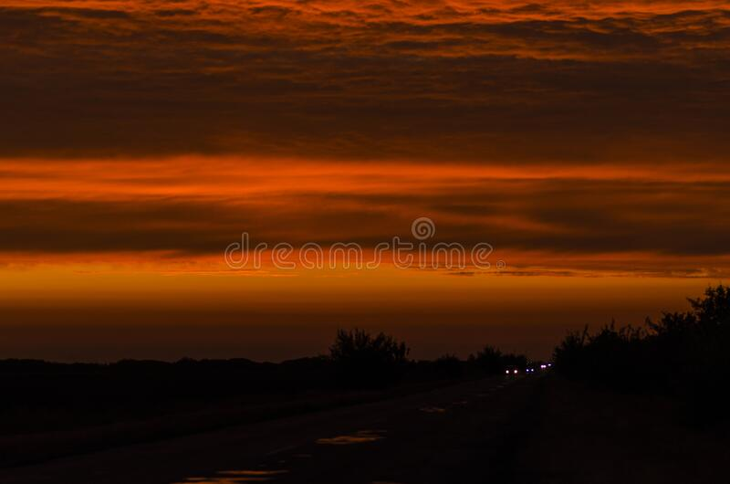 Beautiful sky in vibrant sunset colors and dark tones.  stock photography