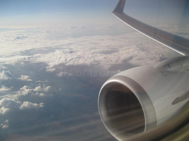 Beautiful sky and wing of an airplane in flight. royalty free stock photography