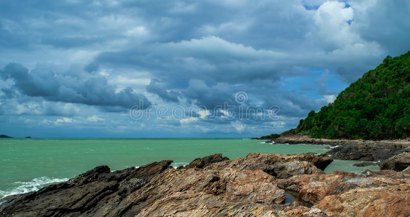 Beautiful skyclouds over the seabeach and big stone on beach at Khao Lam Ya, Rayong province Eastern of Thailand. stock photo