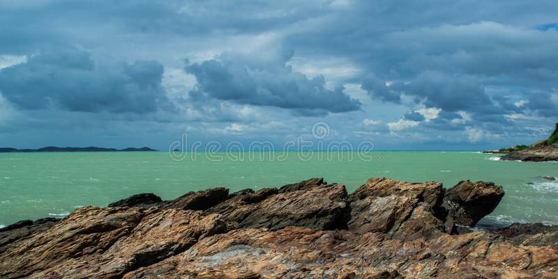 Beautiful skyclouds over the seabeach and big stone on beach at Khao Lam Ya, Rayong province Eastern of Thailand. stock photography