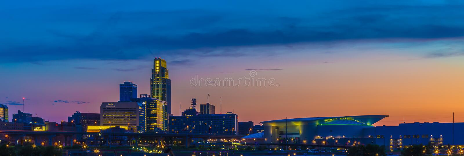 Sunset with beautiful skyline downtown Omaha Nebraska. Beautiful skyline at dusk /sunset over downtown Omaha Nebraska USA. First National bank headquarters is stock photo