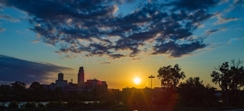 Dramatic Sunset with beautiful skyline over downtown Omaha Nebraska. Beautiful skyline at dusk /sunset over downtown Omaha Nebraska USA with National Bank stock photo