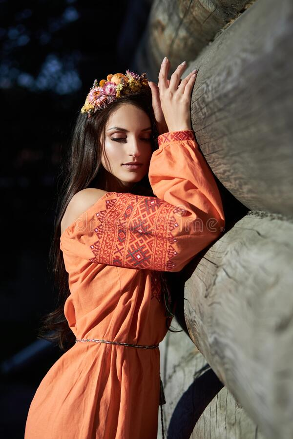 https://thumbs.dreamstime.com/b/beautiful-slavic-woman-orange-ethnic-dress-wreath-flowers-her-head-natural-makeup-portrait-russian-girl-196207655.jpg