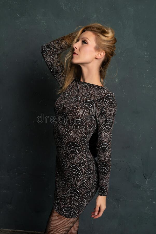 Blonde in a black dress royalty free stock images