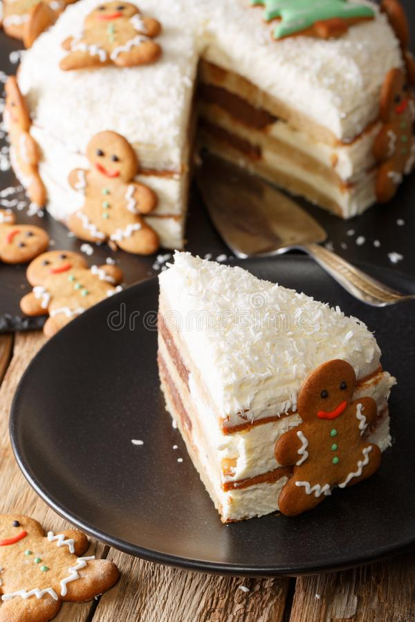 Beautiful slice of Christmas cake is decorated with gingerbread stock image