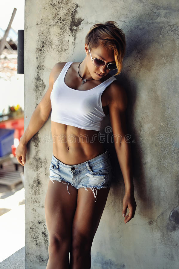 Beautiful slim blonde young woman outdoor fashion portrait stock image
