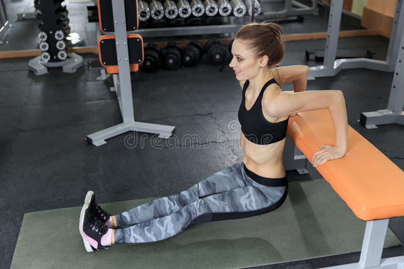 Beautiful slim brunette doing some push ups at the gym royalty free stock photo