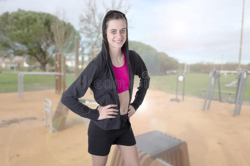 Beautiful slim fitness sporty girl exercise outdoor royalty free stock photos