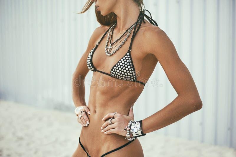 Beautiful slim girl body. Fit female torso stock photos
