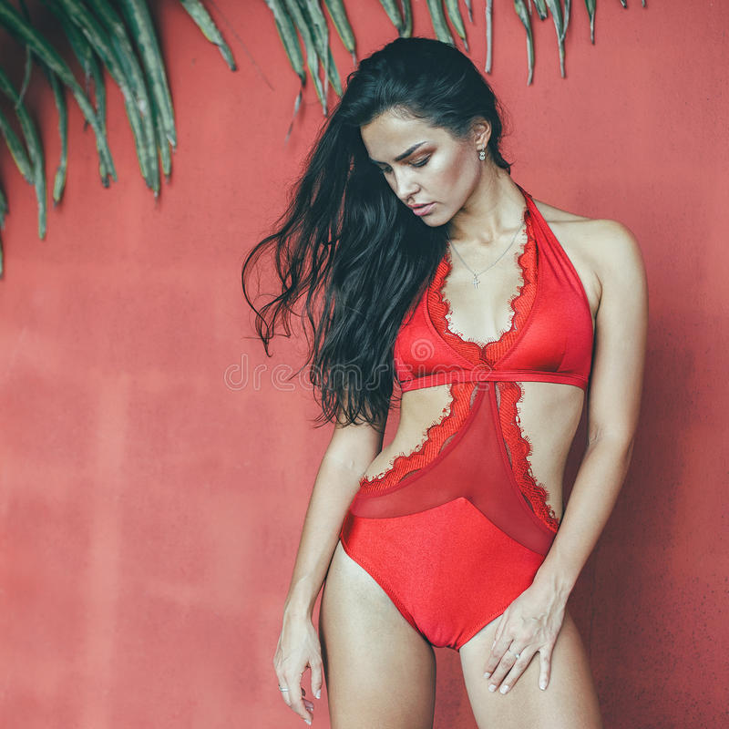 Beautiful slim girl in red bodywear outdoor fashion portrait.  royalty free stock images