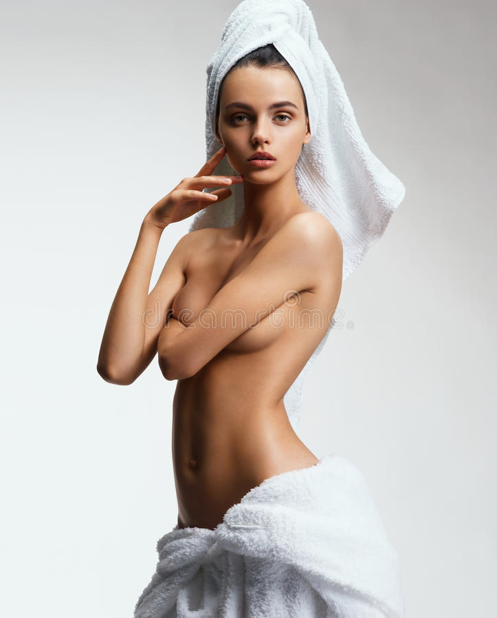 Beautiful slim girl with tanned body after spa. royalty free stock photography