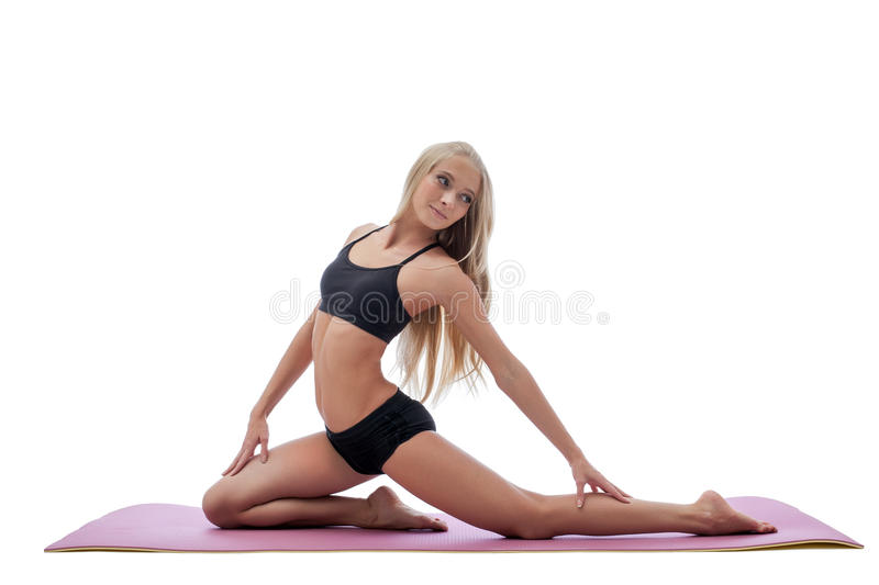 Beautiful slim long-haired blonde doing fitness stock photos