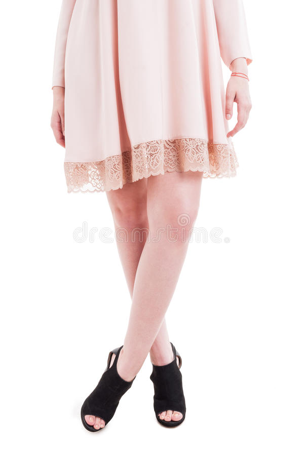 Beautiful slim and long woman legs wearing modern high heels royalty free stock photo
