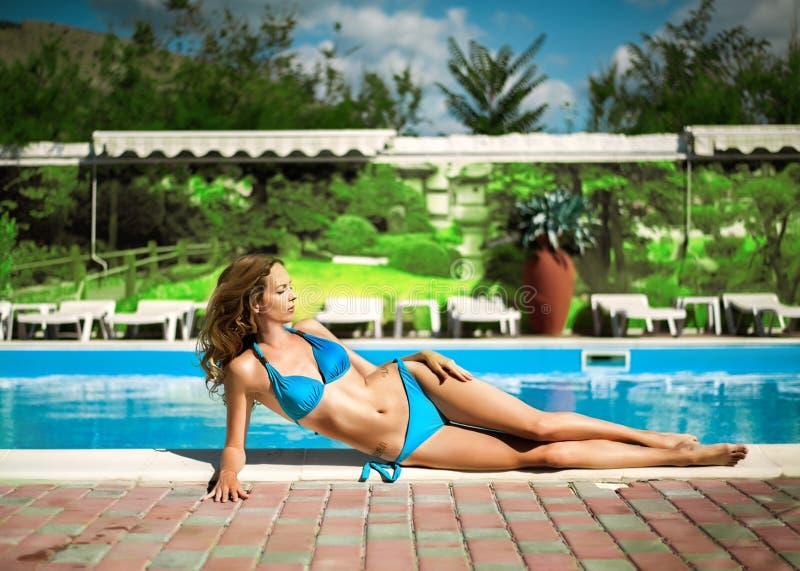 Beautiful slim woman wearing blue bikini stock photography