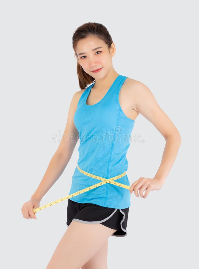 Beautiful slim young asian woman measuring tape thin waist wear uniform fitness isolated white background stock images