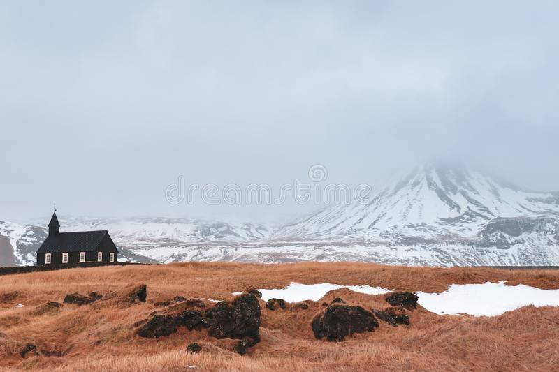 Beautiful small church and snow-covered mountains in Budir, Snaefellsnes. Peninsula, Iceland stock photos