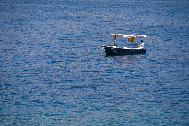 Beautiful small fishing wooden old boat stock photo