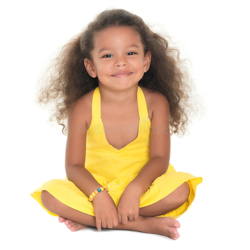 Beautiful small hispanic girl sitting on the floor royalty free stock images