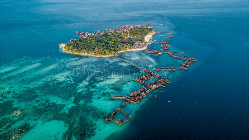 Beautiful small island near Borneo with atoll royalty free stock images