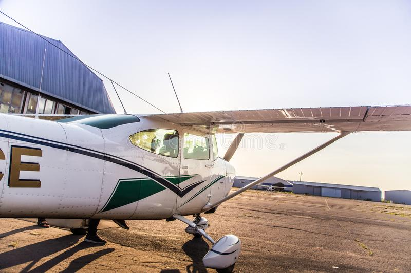 A beautiful small plane waiting to lift off in a private airport royalty free stock photo
