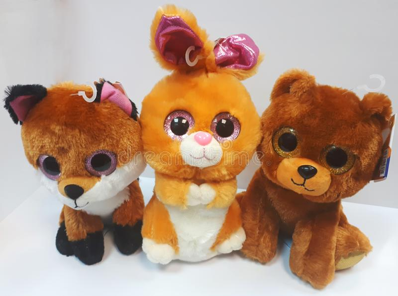 Beautiful small soft toys with big eyes - fox, hare and bear on a white background.  royalty free stock images