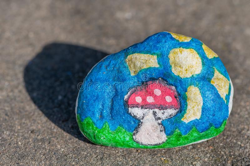 A beautiful small stone painted by a child royalty free stock photos