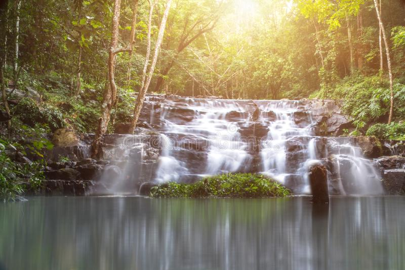 beautiful small waterfall in the wild with sun light,nature stock photography