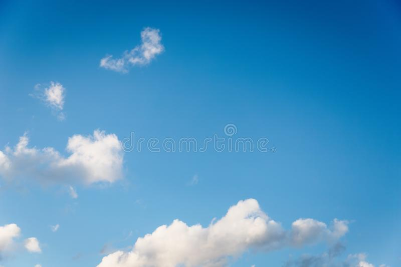 Beautiful small white fluffy clouds on a blue sky background. Copy space royalty free stock image