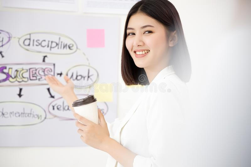 Beautiful smart asian woman entrepreneur startup company. Portrait attractive woman looking to camera and smile royalty free stock photos