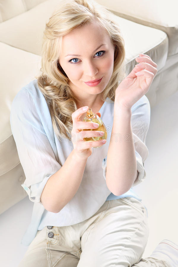 Beautiful smell- woman test perfume on her wrist. stock images