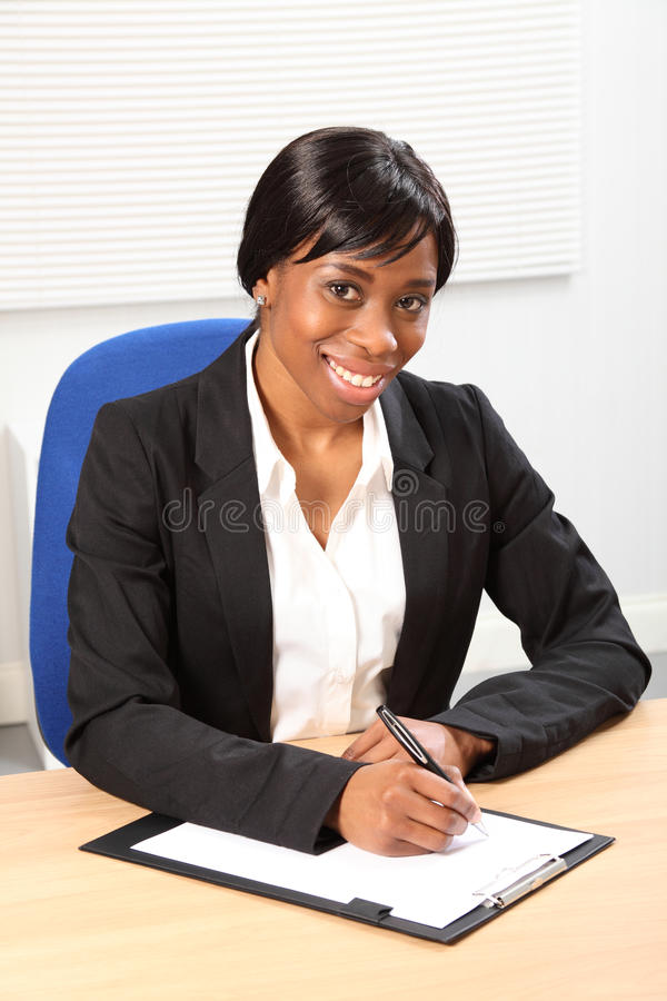 Beautiful smile by black woman in business office stock photography