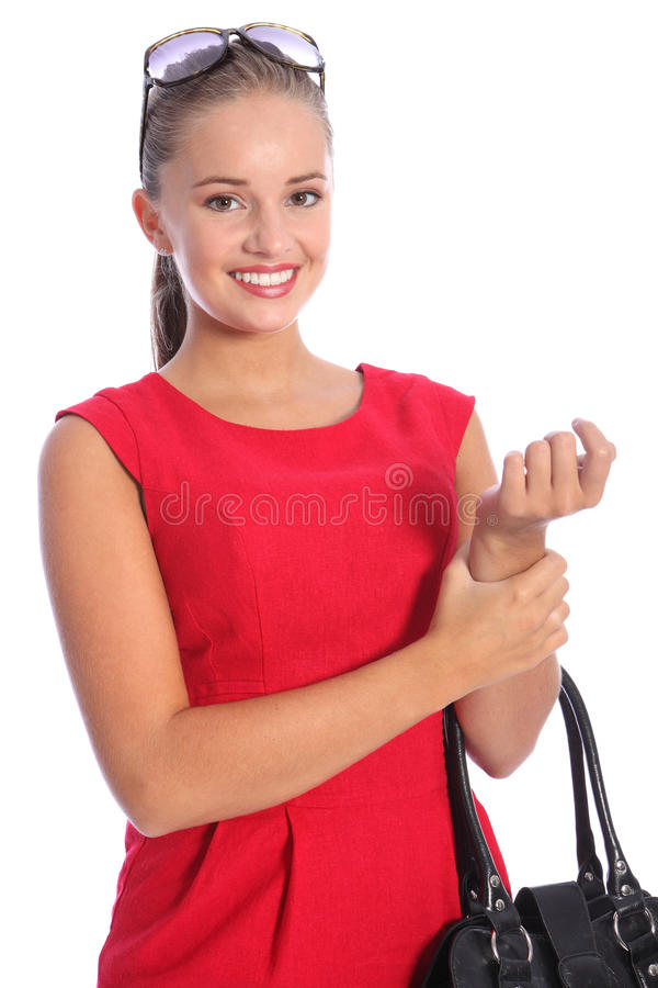 Beautiful smile from posh young woman in red royalty free stock photography